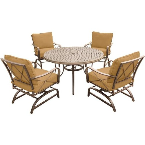 Hanover Summer Nights 5-Piece Outdoor Dining Set with Round Cast-Top Table and Steel Rockers with Desert Sunset Cushions