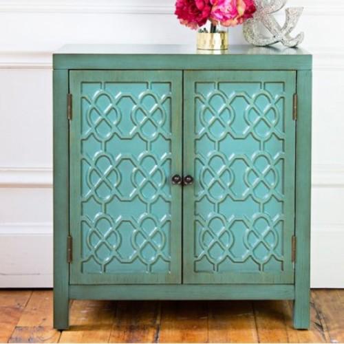River of Goods Antiqued Quatrefoil 2 Door Cabinet with Shelf