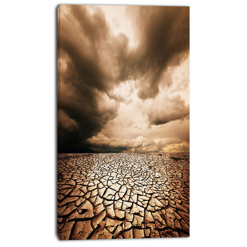 Designart 'Cracked Drought Land with Dark Clouds' Oversized Landscape Canvas Art [option : 12 in. wide x 20 in. high]