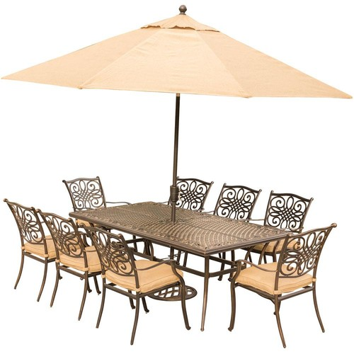 Hanover Traditions 9-Piece Outdoor Dining Set with Rectangular Cast-Top Table with Natural Oat Cushions, Umbrella and Base
